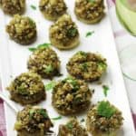 Vegetarian stuffed mushrooms are so easy to make, these are the perfect appetizers for your holiday party