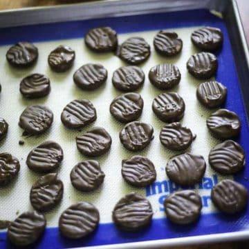 homemade peppermint patties on a baking sheet