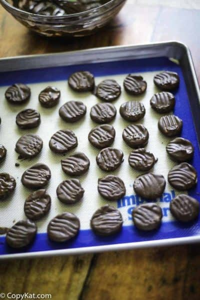 homemade peppermint patties on a baking sheet
