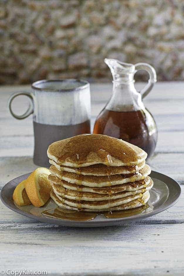 country griddle cakes with syrup on a plate