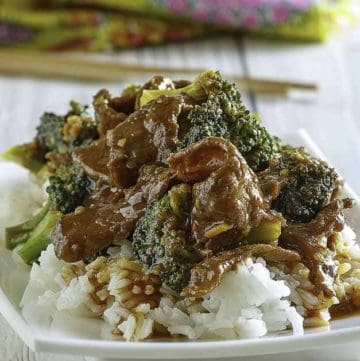 Homemade copycat Panda Express Broccoli Beef and rice on a white plate.