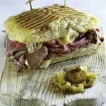 Homemade Panera Bread Steak & White Cheddar Panini on a wood board