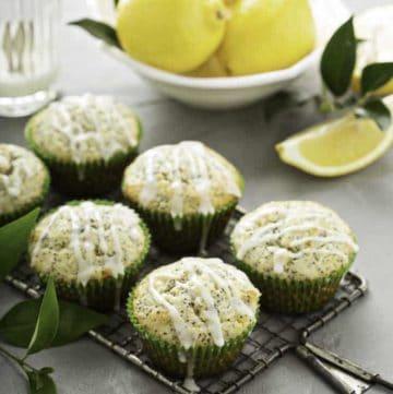 six bakery style lemon poppy seed muffins and lemons