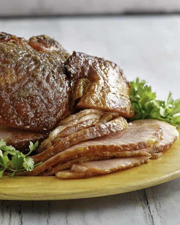 a honey baked ham on a platter.