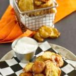 fried pickles on a plate and in a fry basket