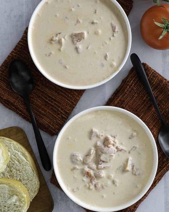 two bowls of creamy tomato soup