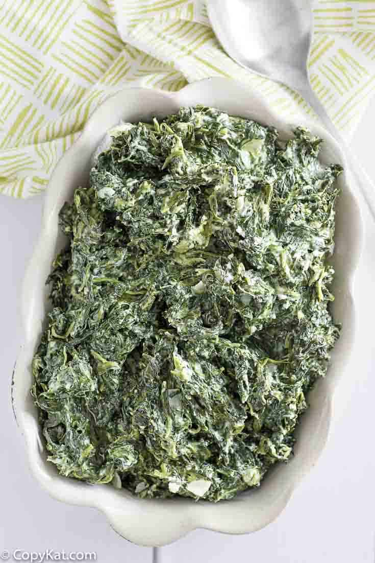 Serving bowl of homemade copycat Boston Market creamed spinach.