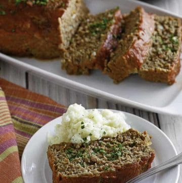 Homemade Boston Market Meatloaf on a plate and serving dish.