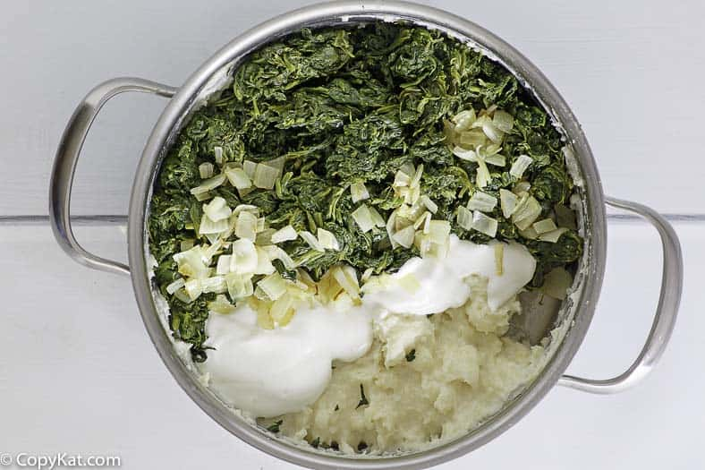 Ingredients for homemade copycat Boston Market creamed spinach in a pan.