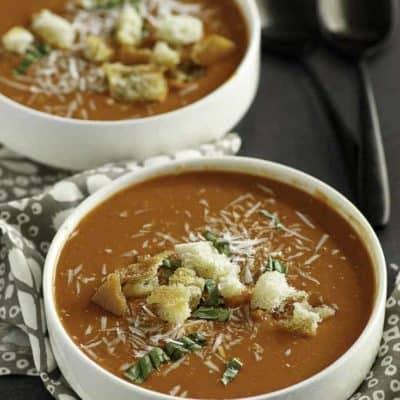 Two bowls of homemade Panera Bread creamy tomato soup.