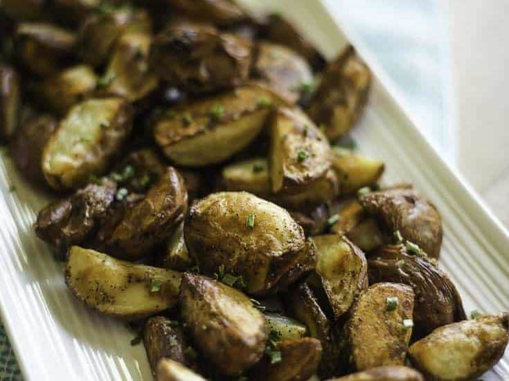 Oven roasted red potatoes on a serving platter.