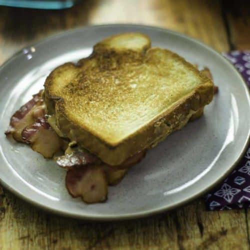 Yes, you can combine peanut butter and bacon for a tasty breakfast sandwich.