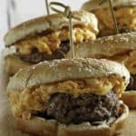 Burger topped with pimento cheese spread.