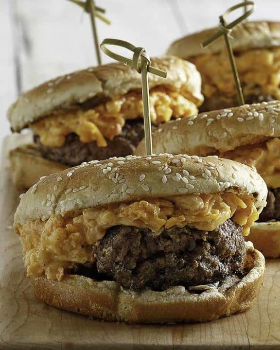 Burgers topped with pimento cheese spread.