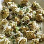 Stuffed mushrooms on a baking these, these are copycat stuffed mushrooms from the Olive Garden.