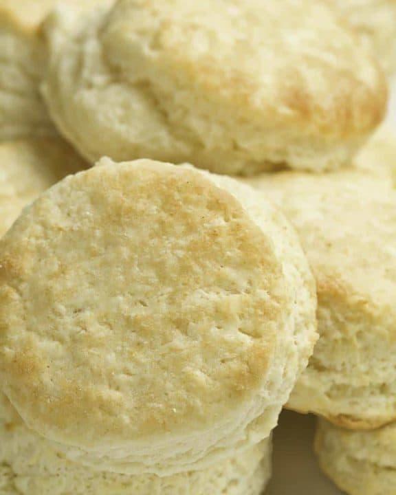 Golden brown Denver biscuits arranged on a plate.
