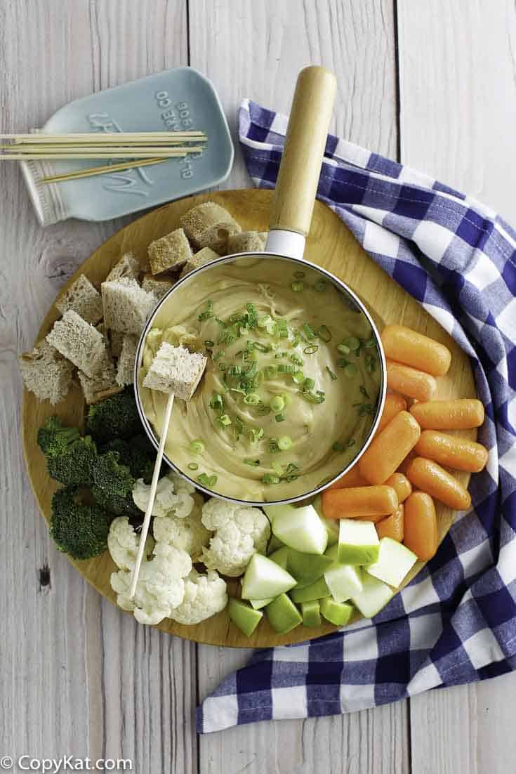Melting Pot Cheese Fondue with fresh vegetables and fruit.