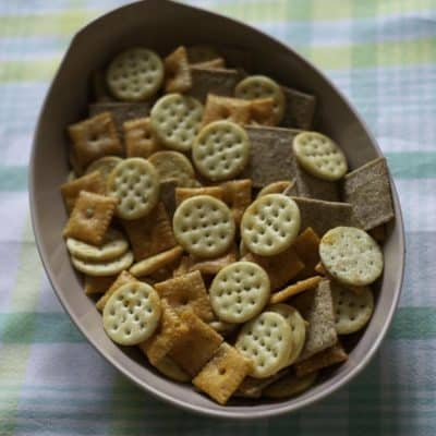 A bowl of three different types of seasoned crackers.