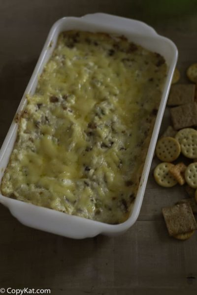 A baking dish full of swiss and bacon dip.