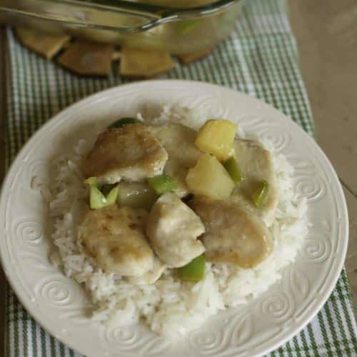 Baked sweet and sour chicken on a bed of white rice.
