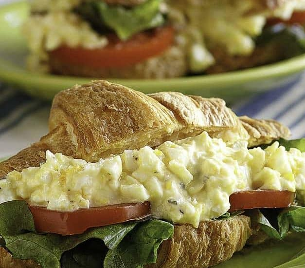 A homemade copycat Chicken Salad Chick egg salad sandwich with lettuce and tomato