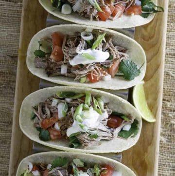 Four pork tacos filled with copycat chipotle pork carnitas
