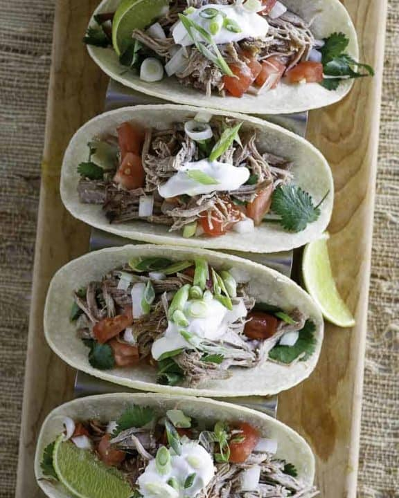 Four pork tacos filled with copycat chipotle pork carnitas