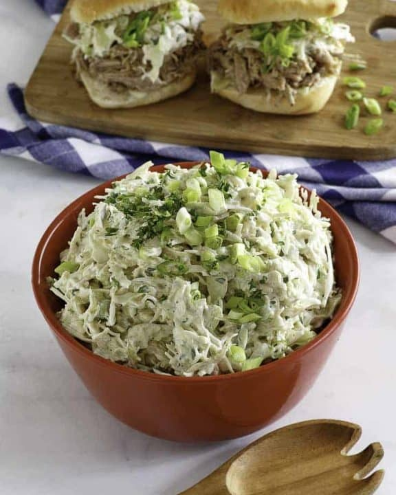 Homemade Houston's coleslaw in a bowl and on pork sandwiches