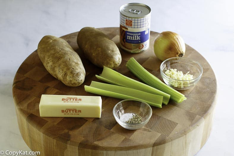 Ingredients for potato soup: potatoes, celery, evaporated milk, butter, garlic, and seasonings.
