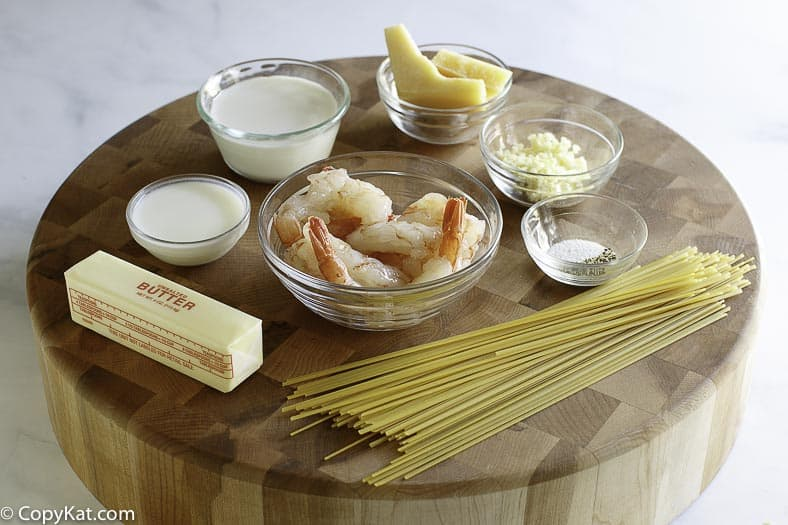 Butter, Heavy Cream, Parmesan Cheese, Pasta, Shrimp and more make the Ingredients for Olive Garden Shrimp Alfredo.