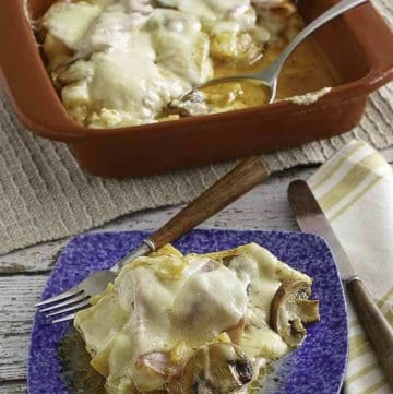 A copycat recipe pictured of the Mason Jar Mesquite Chicken topped with cheese.