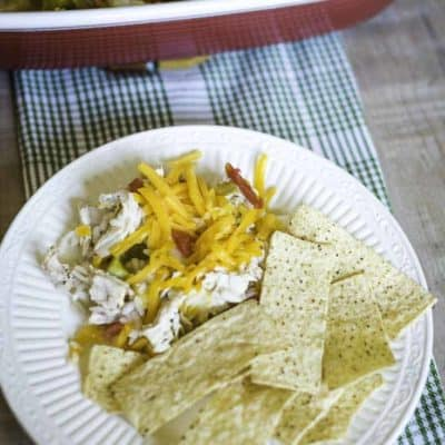 Spanish chicken and rice casserole served with corn chips.