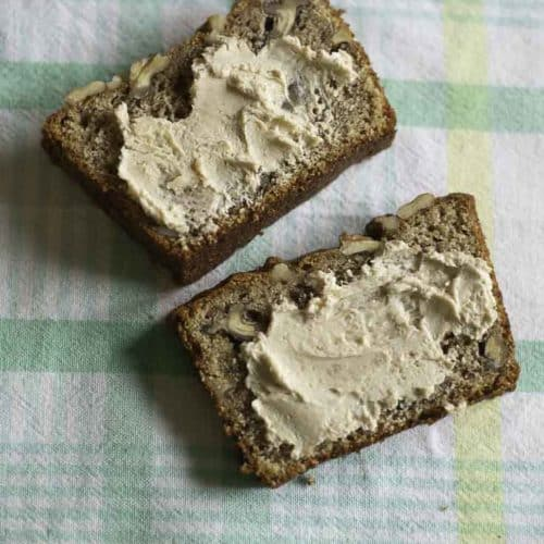 Two slides of whole wheat banana bread with butter.