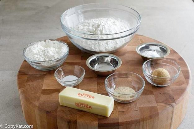 Ingredients for making a soft pretzels; all-purpose flour, bread flour- baking soda, salt, butter, and more.
