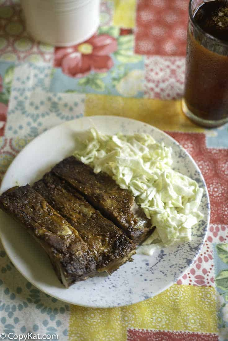A plate of ribs and homemade coleslaw made with heavy cream, vinegar, and sugar