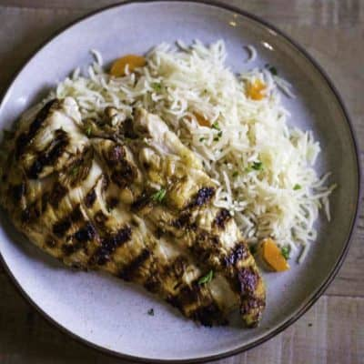 Homemade Chilis Margarita Grilled Chicken breast on a plate with rice pilaf