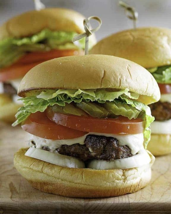 three butter hamburgers with cheese