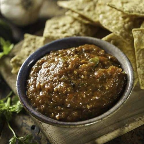 A bowl of homemade mexican hot sauce and tortilla chips