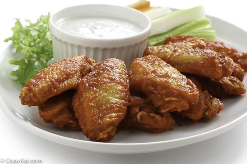 Junior's buffalo wings and blue cheese salad dressings on a plate