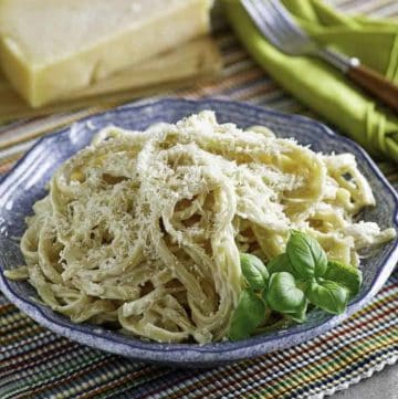 A bowl of pasta with homemade Olive Garden Alfredo sauce.