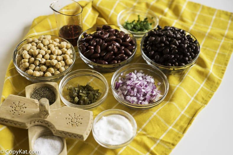 Garbonzo beans, red kidney beans, black beans, red onions, pickled jalapenos and more