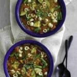 Two bowls of homemade minestrone soup, full of fresh vegetables and pasta