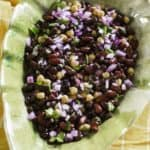 mexican three bean salad with red onions, cilantro in a bowl