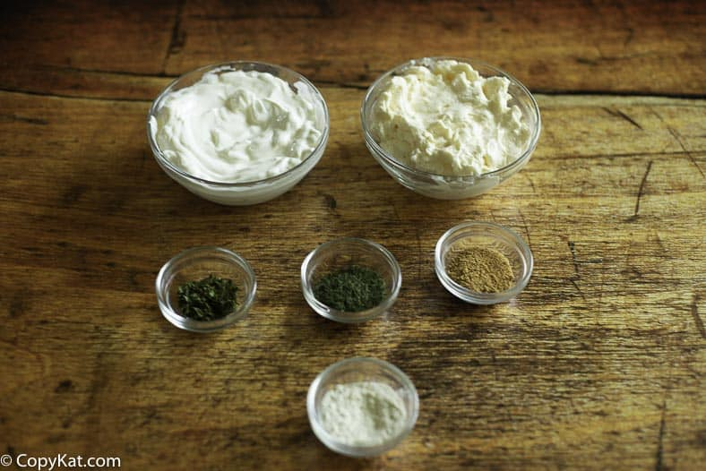 Ingredients for sour cream, mayonnaise, dill, parsley, seasoned salt, and onion powder.