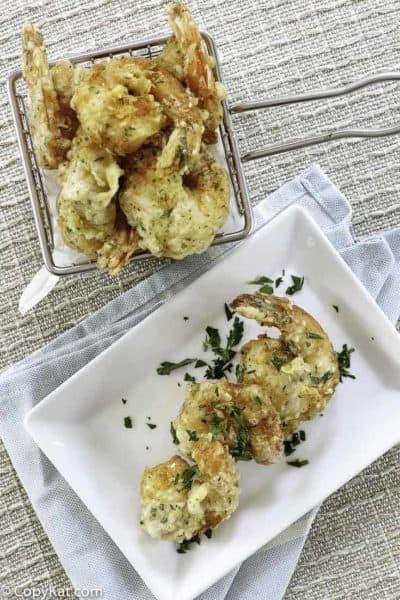 A basket and a plate of homemade shrimp tempura