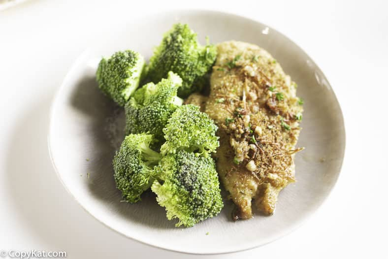 Oven baked lemon pepper garlic chicken with broccoli on a plate