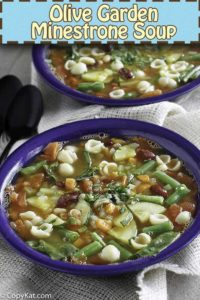 Homemade Olive Garden minestrone soup in a blue bowl.