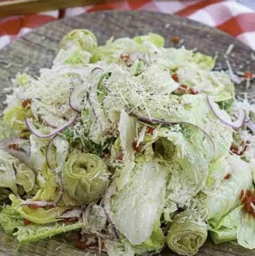 salad with romain and iceberg lettuce, artichokes and more