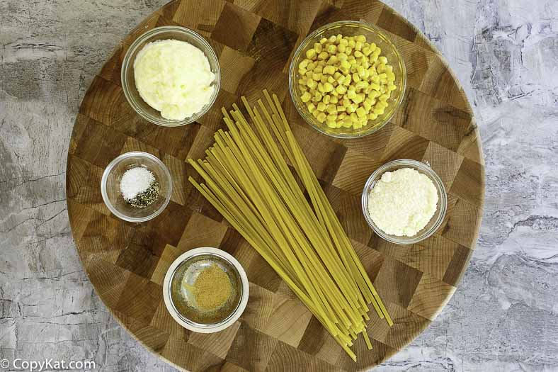 Ingredients for Fettuccine Salad: fettuccine, mayonnaise, parmesan cheese, corn, garlic powder, and more