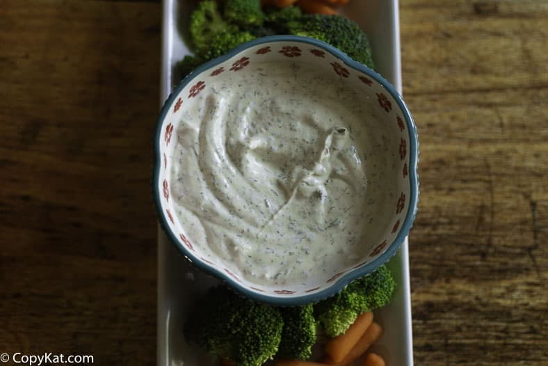 A bowl of vegetable dill dip with fresh vegetables